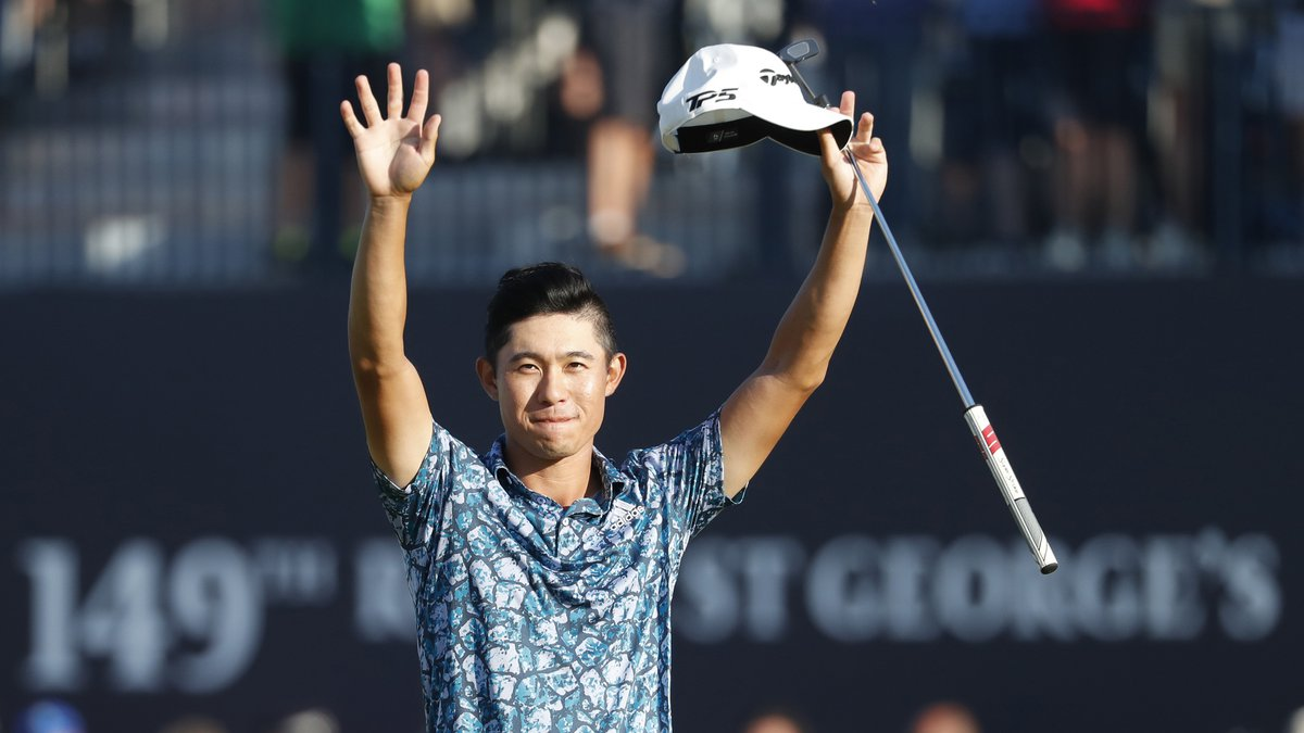 Collin Morikawa celebrates on the 18th green after winning the British Open Golf Championship...