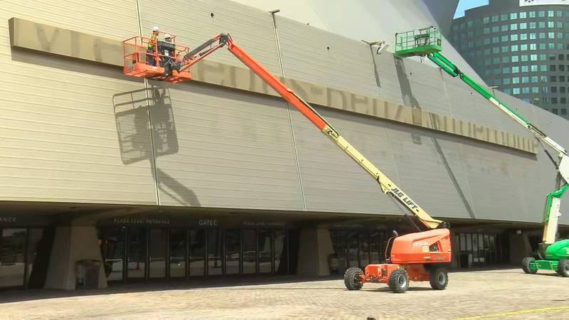 """Crews removed the """"Mercedes-Benz"""" letters from the Superdome on July 15."""