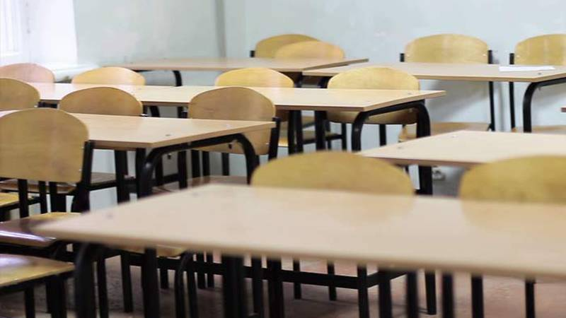 With another COVID spike, there are questions about whether school districts should switch to...