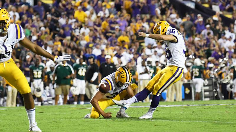 LSU senior kicker Cole Tracy makes a point-after kick against the Southeastern Lions on Sept....