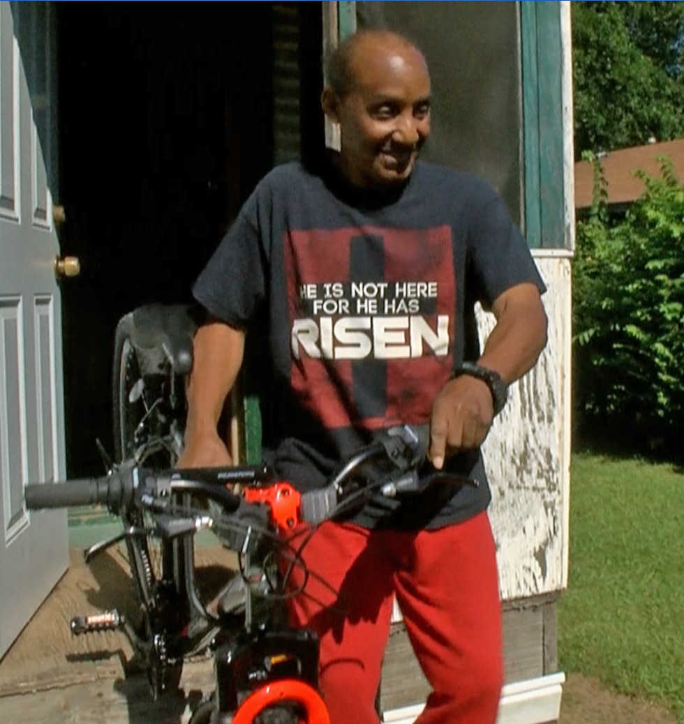 Wayne Willis, 72, shows off his brand-new bicycle just delivered this week by Shreveport police...