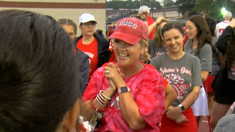 Kelli Shaw is surrounded by dozens of former Haughton High School cheerleaders.