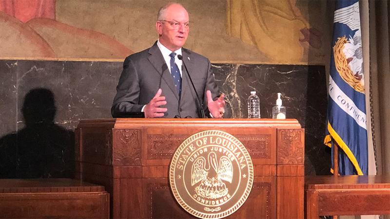Louisiana Gov. John Bel Edwards announces easing of statewide mask mandate and coronavirus...