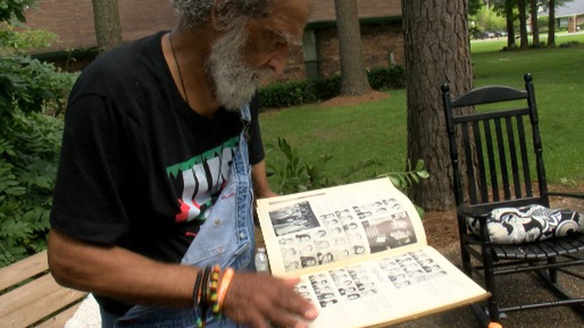 Air Force Veteran Kenneth Armand looks back at his yearbook when he attend Grambling State...