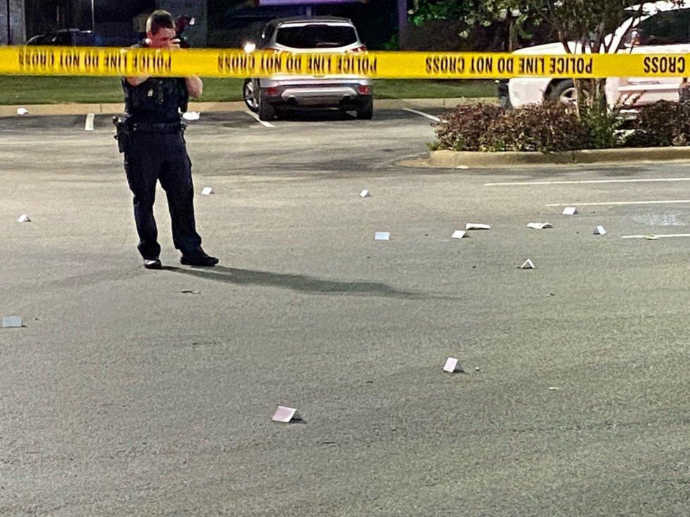 Tyler PD gathering evidence, shell casings.