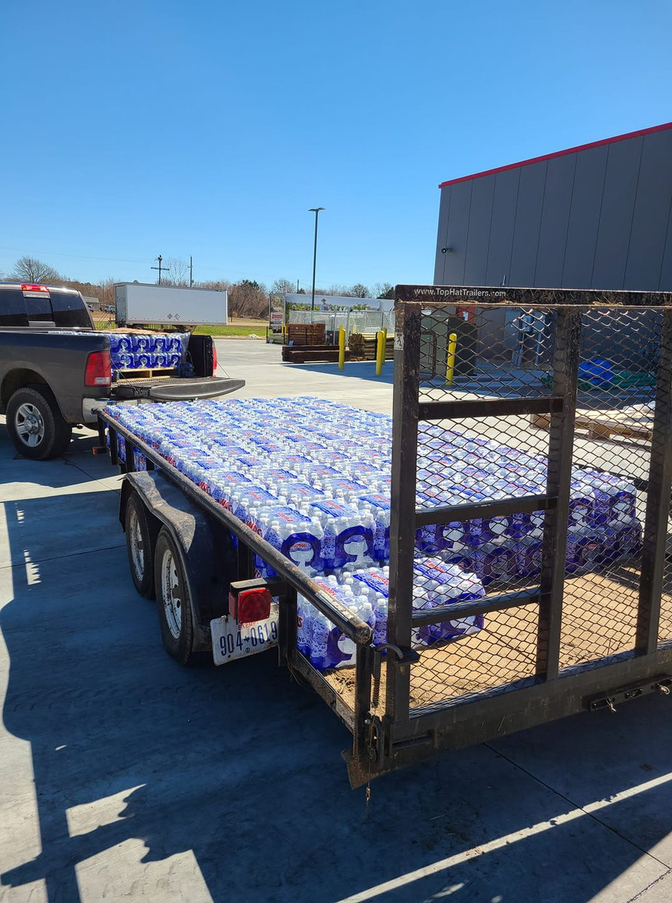 Nolan Williams loads his trailer for a day of bottled water distribution.