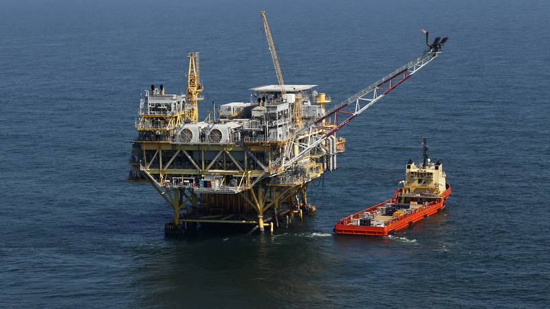 This Sunday, April 10, 2011 picture shows a rig and supply vessel in the Gulf of Mexico, off...