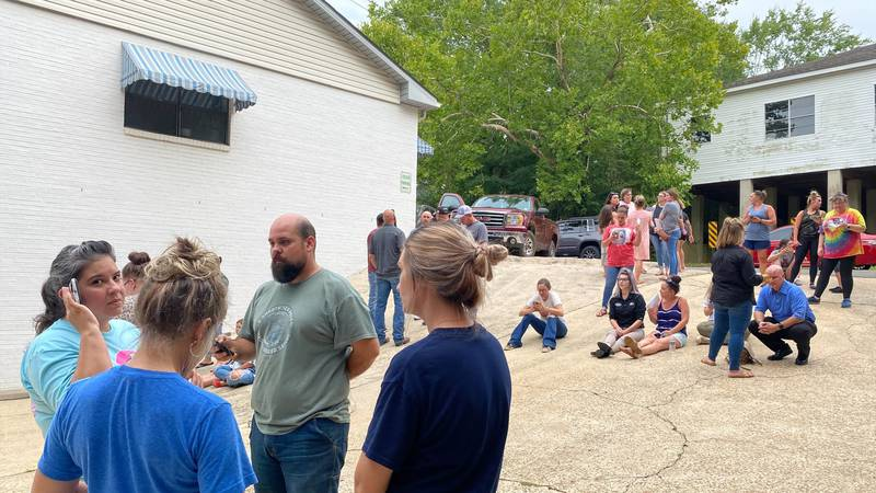 People gather ahead of a special meeting Aug. 9, 2021, called by the Sabine Parish School Board...