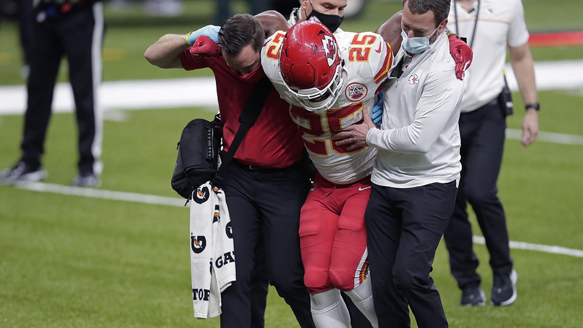 Kansas City Chiefs running back Clyde Edwards-Helaire (25) is carried off the field after being...