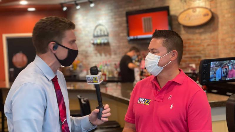 From left: Meteorologist Andrew Brightman interviews his boss, Jeff Castle during a fundraising...