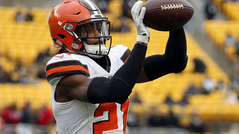 Cleveland Browns cornerback Denzel Ward catches a ball before an NFL football game between the...