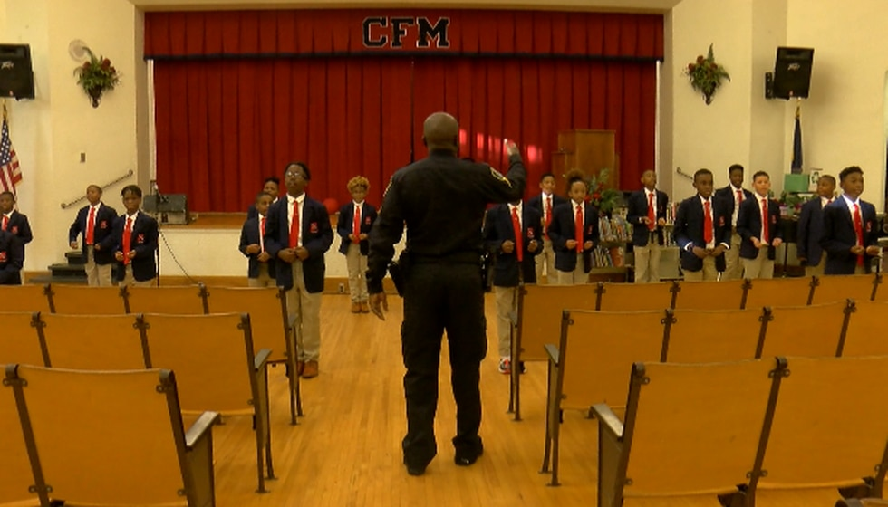 Claiborne SRO Rodney Bradley instructing the students of the group, 'Young Distinguished...
