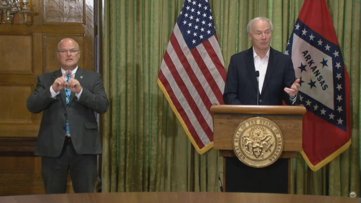 Gov. Asa Hutchinson discusses new COVID-19 details during a press conference Saturday in Little...