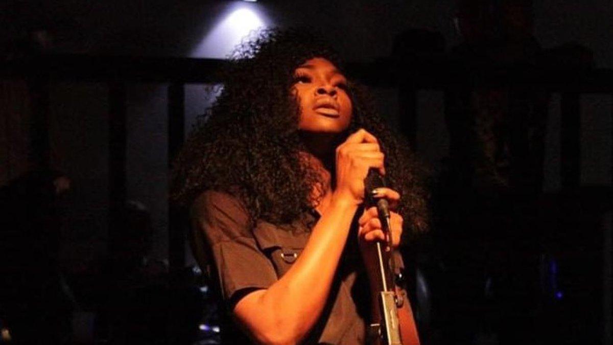 Adreana Burton, a Shreveport singer/songwriter, performs a song.