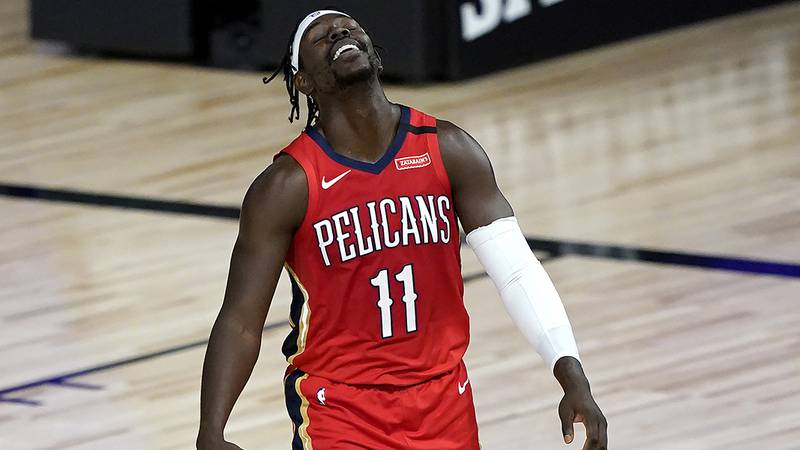 New Orleans Pelicans' Jrue Holiday reacts during the first half of an NBA basketball game...