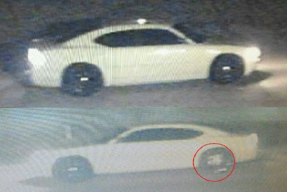 Along with the video from the ATM theft, police also released photos of a white Dodge Charger...