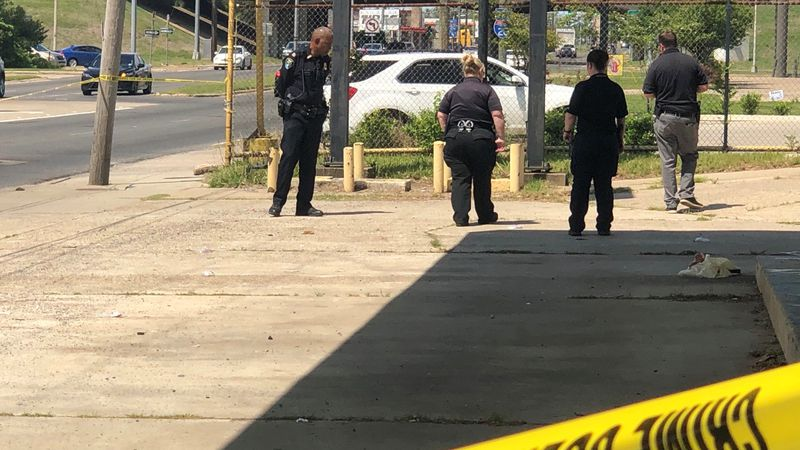 Shreveport police officers search for more evidence Monday, April 19 at a crime scene on Hearne...