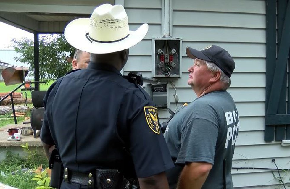 Authorities were back at the New Boston, Texas, house July 9 investigating what happened....