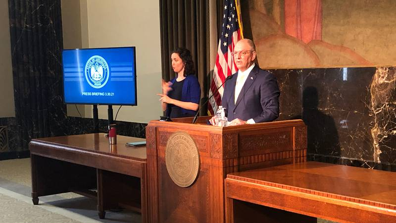 Louisiana Gov. John Bel Edwards announces an easing of restrictions on most of the state's...