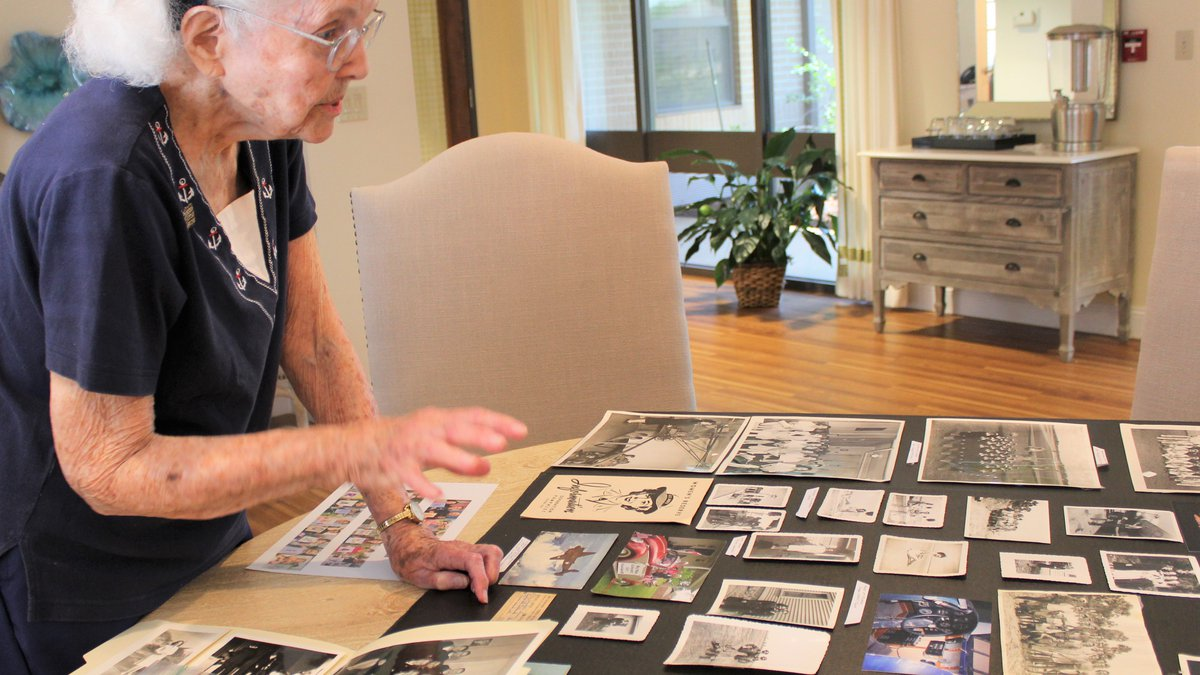 Mary Melson shows off pictures of her life back during World War II.