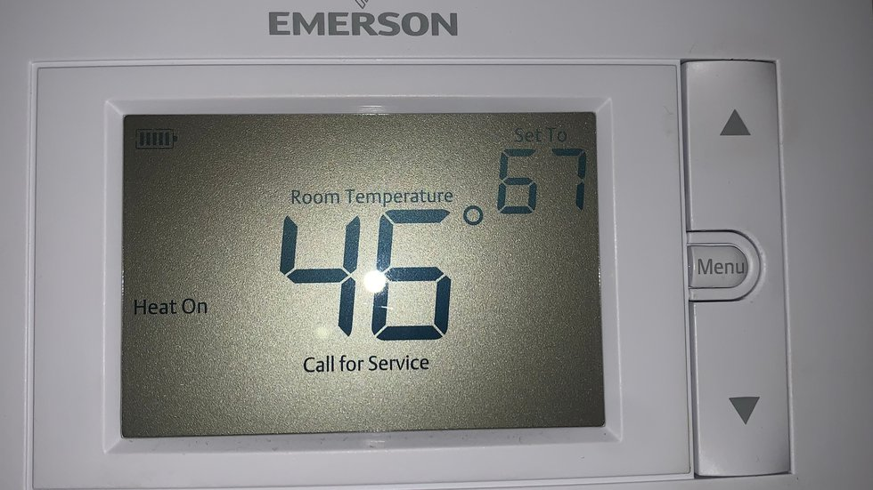 A viewer without electricity shares a photo of her home's thermostat showing 46° early Tuesday,...