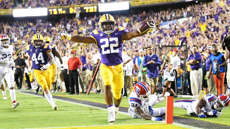 Running back Clyde Edwards-Helaire scores on a 28-yard run against Louisiana Tech on Sept. 22,...