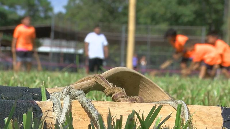 kids play a game of stickball at the recent Ala-Cous stickball tournament in Polk County...
