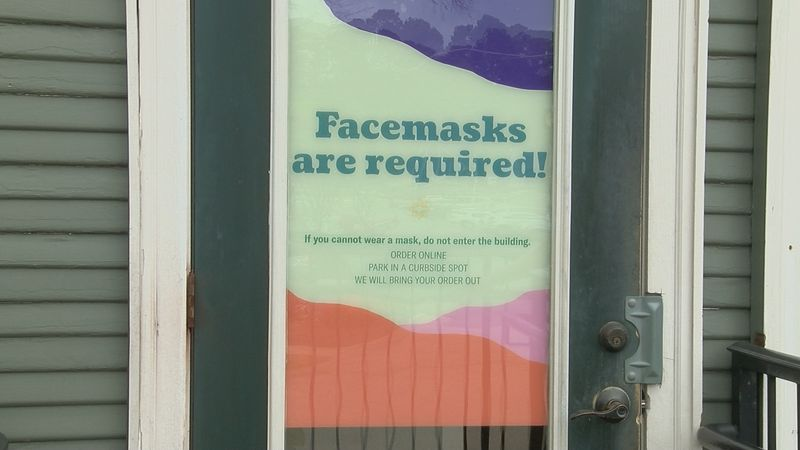 Some businesses will continue to require customers to wear face masks after the state's mask...