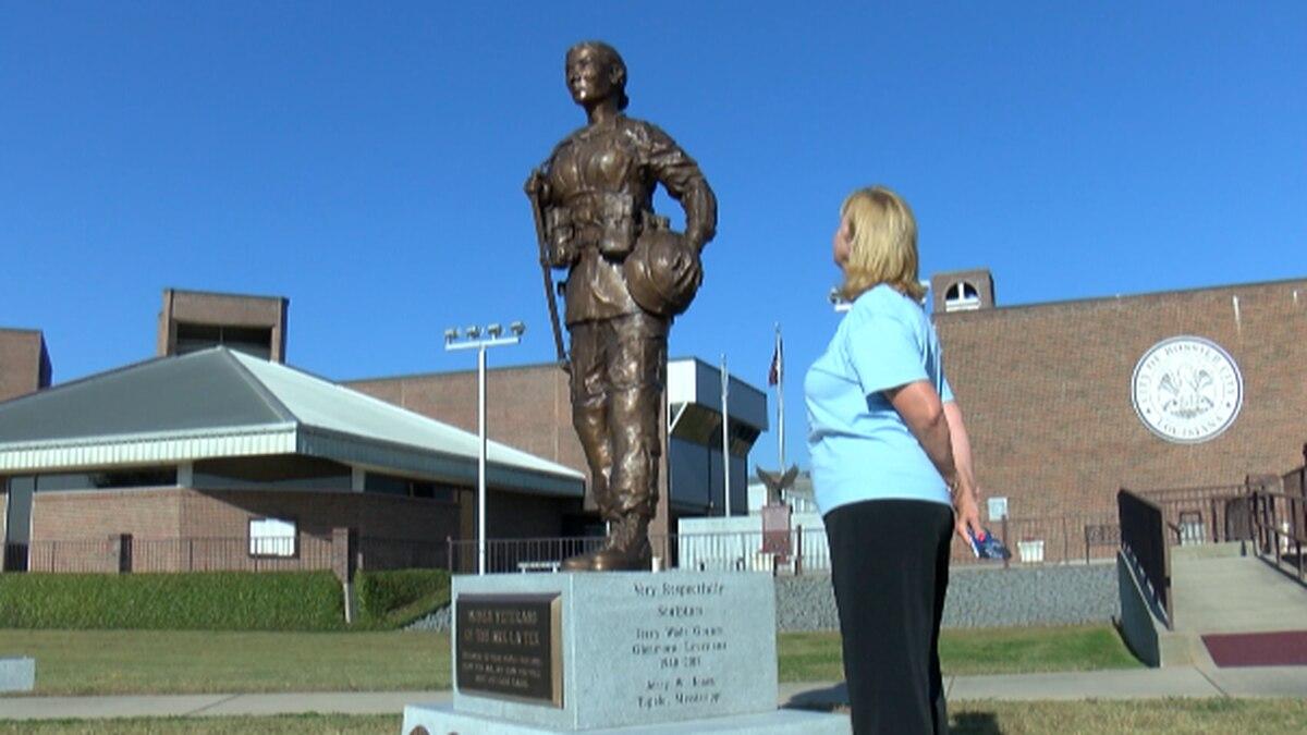 Sandy Franks, the President of the Women Veterans of the ArkLaTex, stands by the Women Veterans...