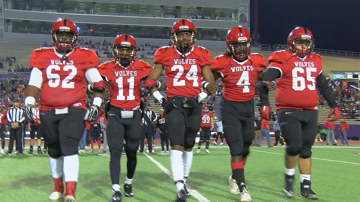 Captains for the San Augustine Wolves make their way to midfield for the coin flip.(Source:...
