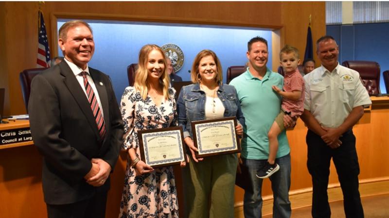 The life saving trio receiving the Life Saving Award with Easton.
