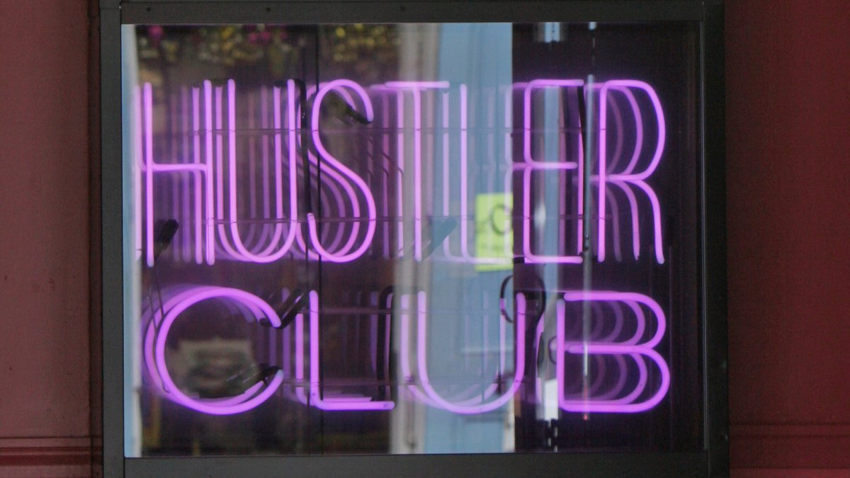 """The entrance to the Hustler Club says """"Relax...It's just sex,"""" on Bourbon Street in the French..."""