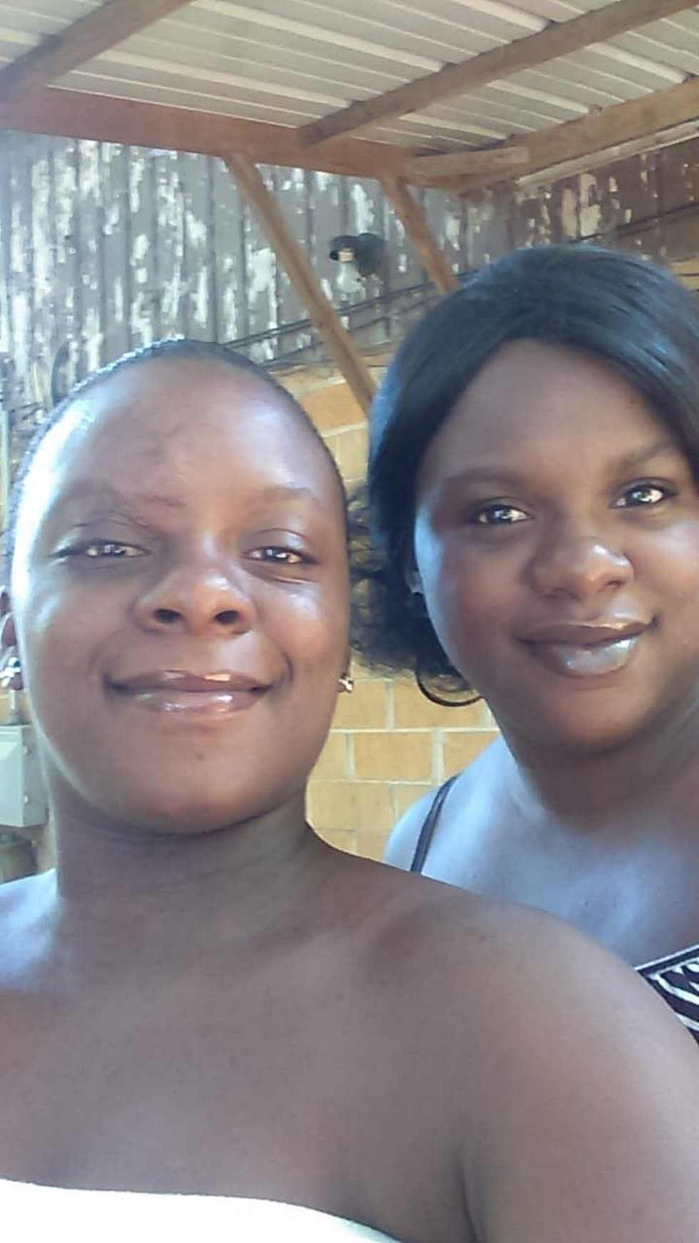 Daymetra Jacobs with her sister Laquania Hopkins who was killed in a crash the evening of March...