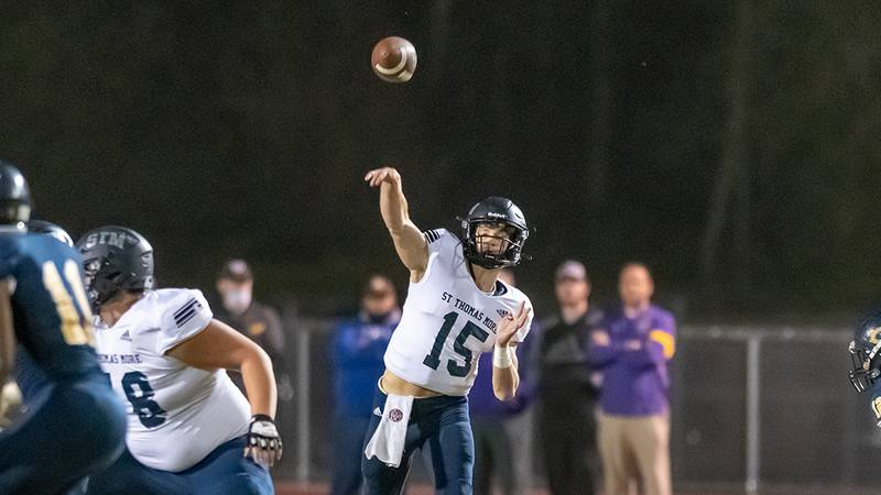 St. Thomas More quarterback Walker Howard (No. 15) throws a pass against Carencro on Nov. 13,...