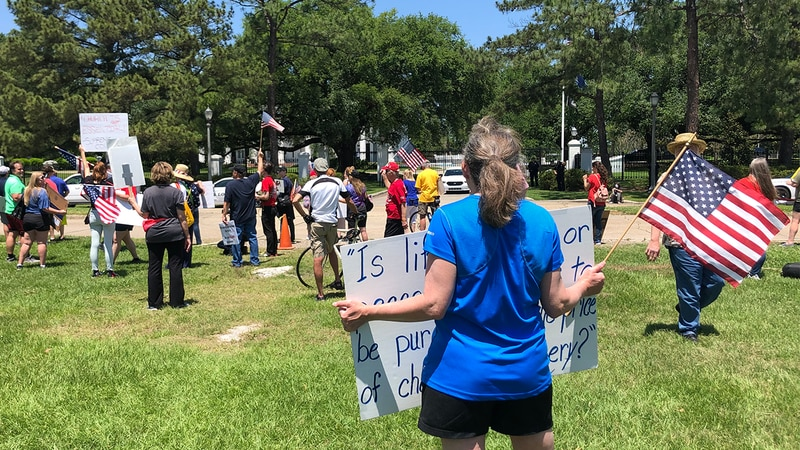 Protesters marched from the Louisiana Capitol to the Governor's Mansion demanding Governor John...