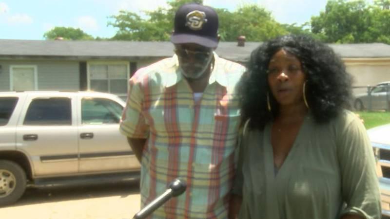 Marvette Little, with Mooretown Neighborhood Association President Lester Smith by her side,...