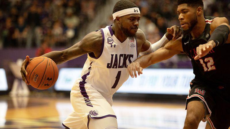 Kevon Harris drives to the basket against Lamar (Source: SFA Athletics)