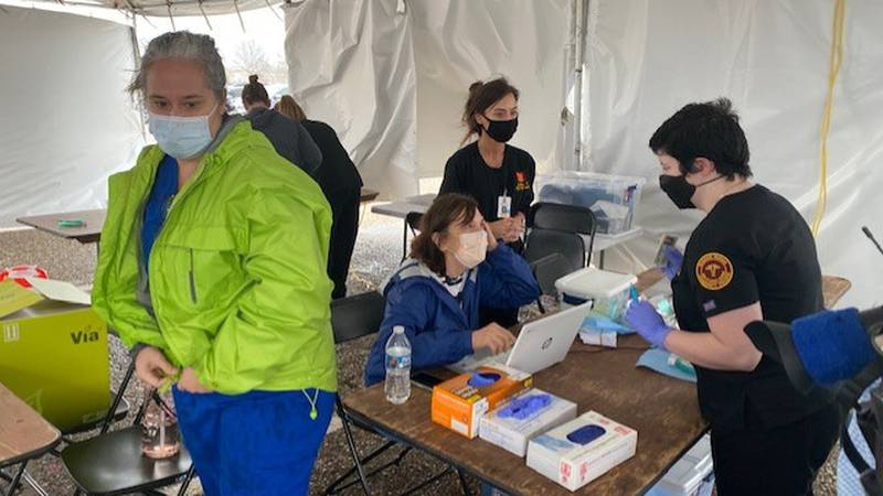 Crews administering the COVID-19 vaccine at the Shreveport fairgrounds braved a rainstorm on...